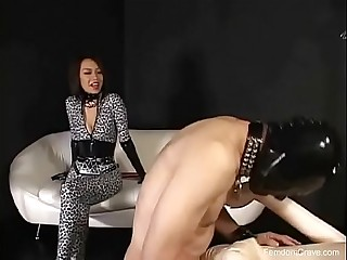 Mistress in jumpsuit pegging