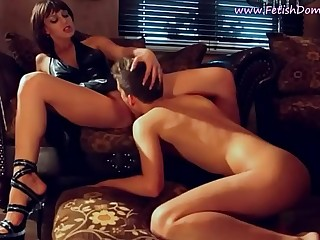 Slave meekly licks the pussy of her goddess.