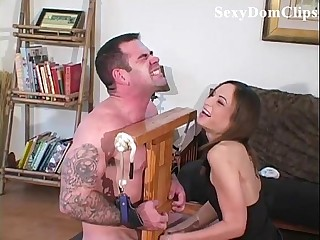 Amber Rayne gives a sensual, painful ballbusting to a sexy guy
