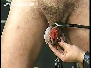 Mistress wearing leather drips hot candle wax over dirty slave his cock and balls
