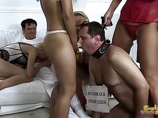 Mistresses-Feed-Banana-To-Cuckold-Frank-For-Blowjob-Lesson