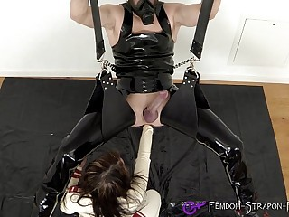 Rubber-nurse anally fists her male slave