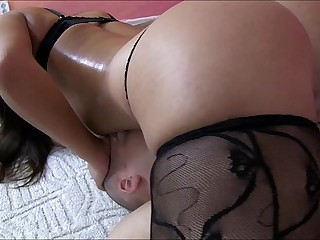 Mistress in lingerie smothers slave with her stomach and breasts
