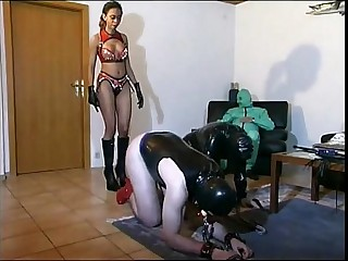 Hot femdom playing with her slaves