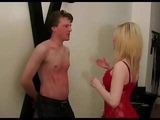 Young Femdom Mistress dominate man in BDSM Studio
