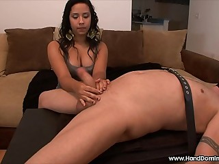 spanish girl evaluates cock during FemDom handjob